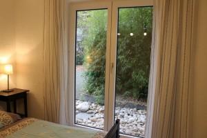 Ferienhaus H1 - Schlafzimmer EG Aussicht